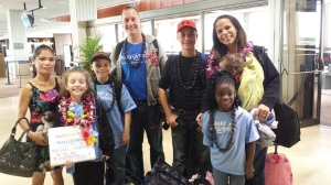 Just off the plane.  Our lei greeting!  Tired, but happy people!